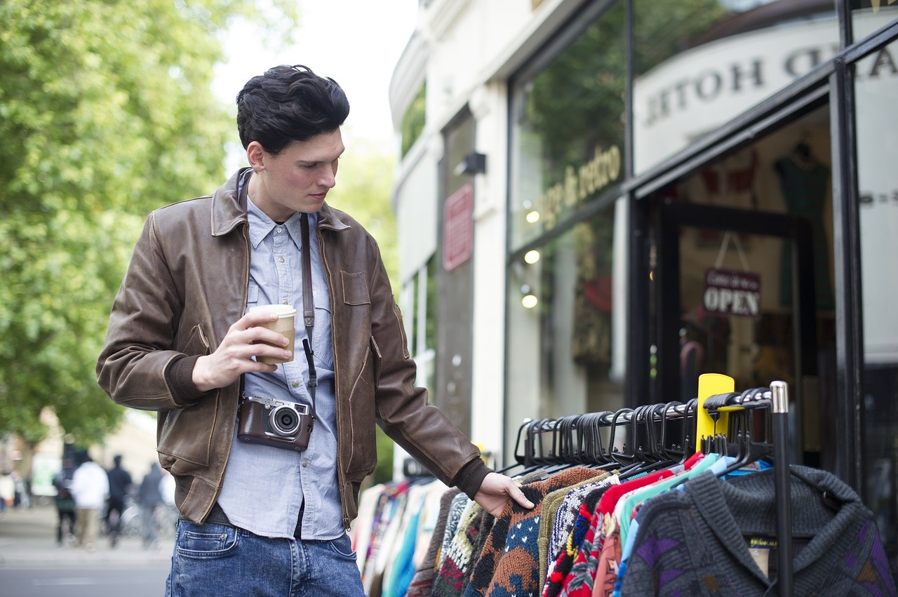 Bargain Hunter Looking at Sweaters Outdoors