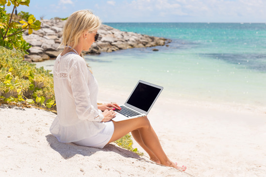 Businesswoman Working on the Beach