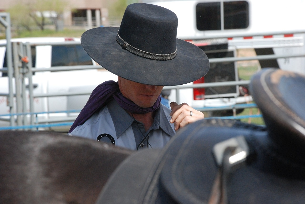 Cowboy in Black Hat Preparing for a Rodeo