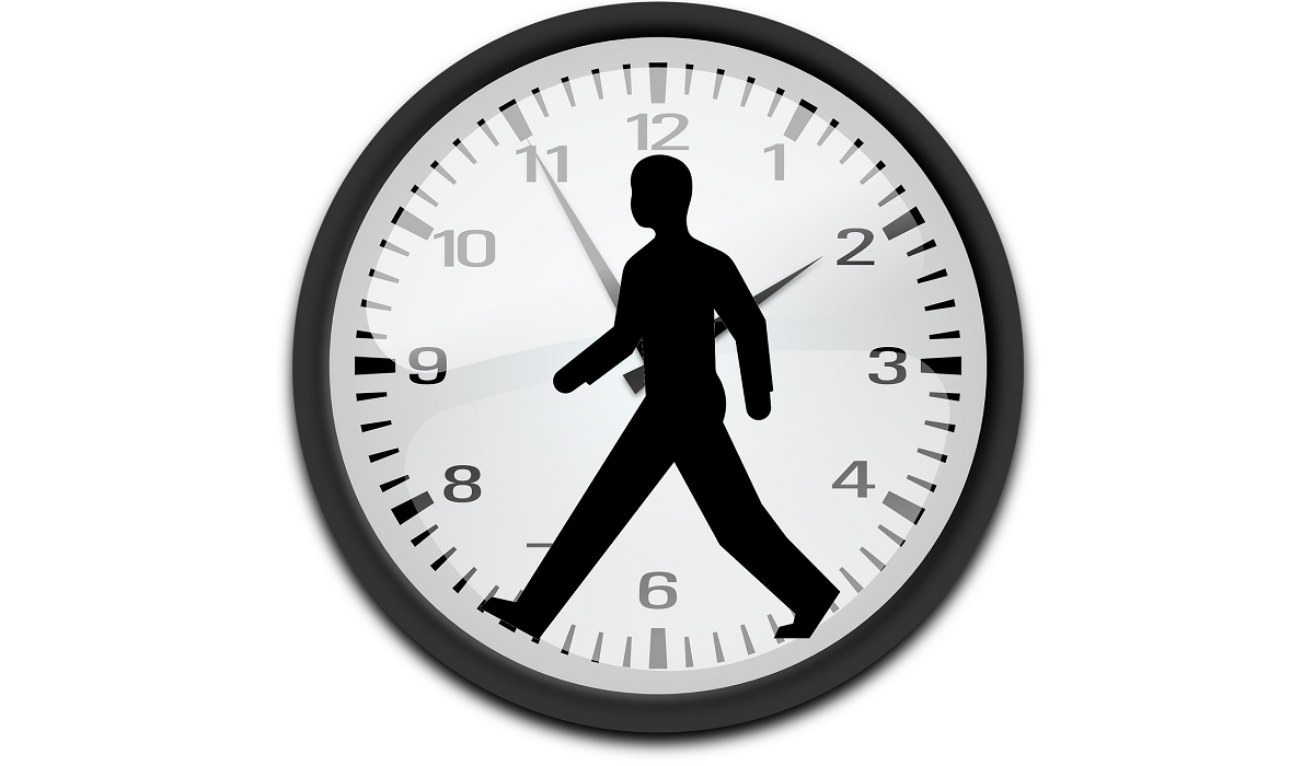 Man Walking Inside Clock