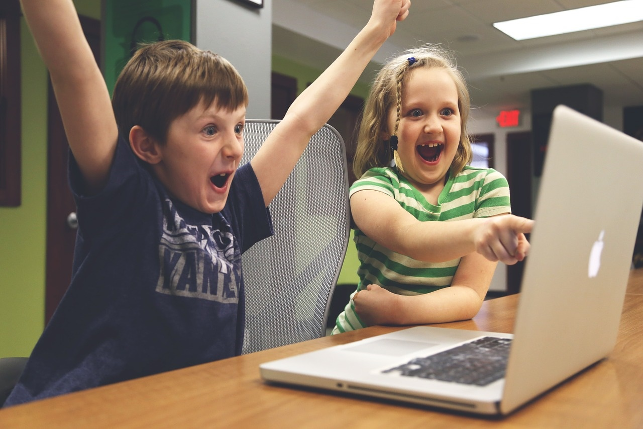 Excited Kids at a Computer