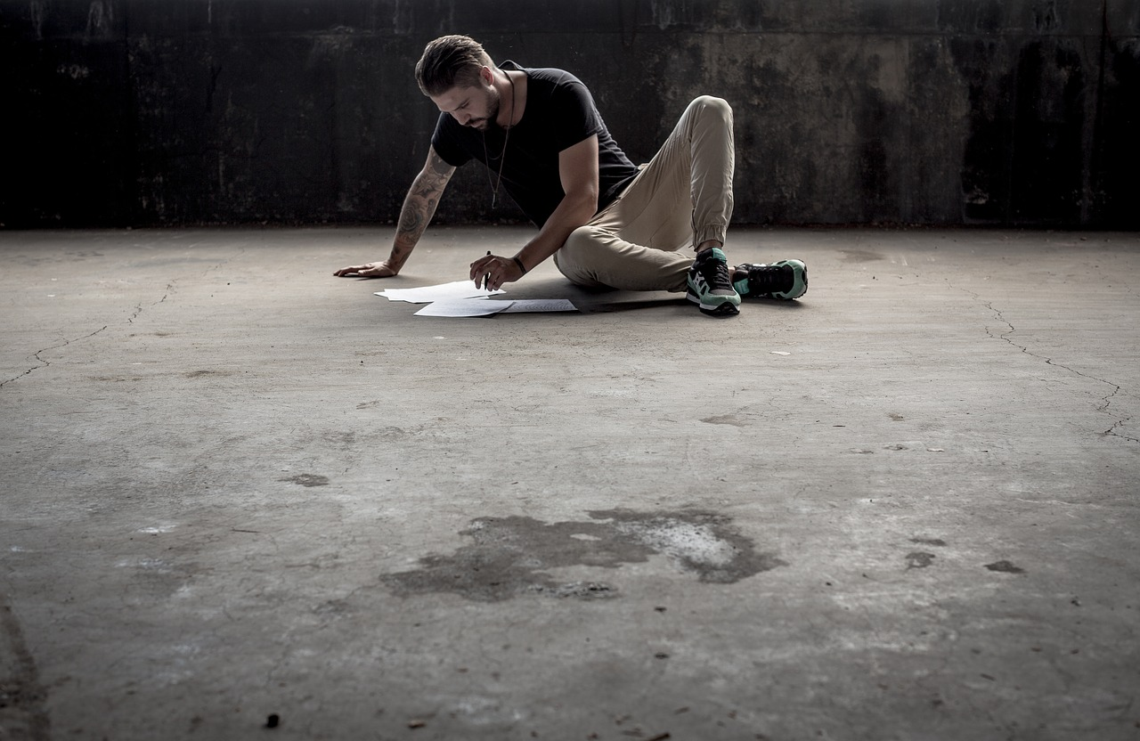 Man on a Concrete Floor, Writing